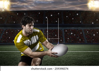 Rugby player in a yellow uniform on a stadium.
