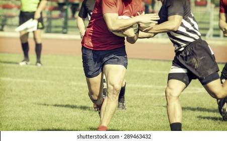 Rugby players fighting for ball - sports concept, retro style photo