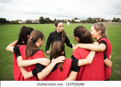 Rugby players and their coach gathering before a match