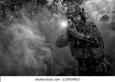 Rugby Warwickshire UK 06/04/2018. Airsoft participant with replica airsoft firearms and military clothing