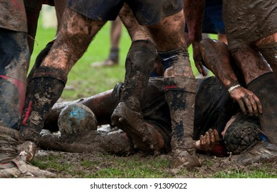 rugbymen lying down in rugby scrum