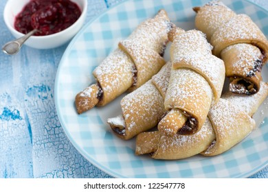 Rugelach with Raspberry jam filling on the light blue plate