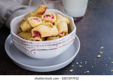 Rugelach (shortbread cookies) with jam filling on stone concrete table background