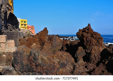 rugged Atlantic coast, lined with lava stones and houses like swallow's nests to the rocks