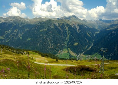 rugged Austrian Alps mountain range with valley and summer sky