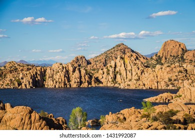 The rugged beauty of Watson Lake in Prescott Arizona.  This reservoir is surrounded be weathered cliffs of the Granite Dells and blear blue skies.