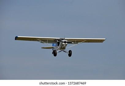 Rugged bush propeller airplane final approach for landing