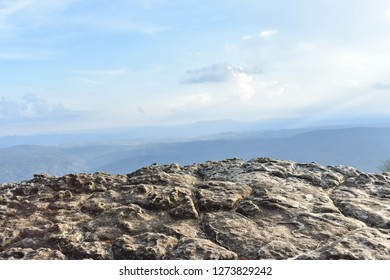 Rugged cliffs on foreground and clear sky view in the background at Phu Kra Dueng National Park, Loei Thailand.
