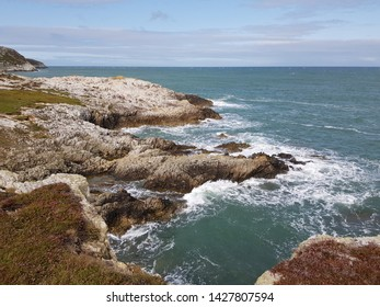 Rugged coastline with sea and sky. Room for text.