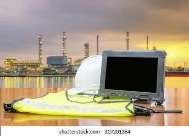 Rugged computers tablet in front of oil refinery industry