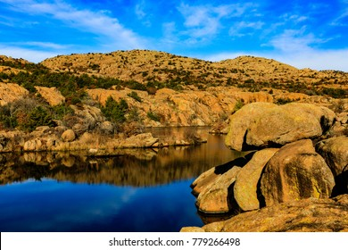 Rugged landscape meets smooth water as it winds between the rock at Wichita Mountains National Wildlife Refuge, November 2017