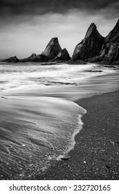 Rugged long exposure landscape seascape of rocky coastline  black and white