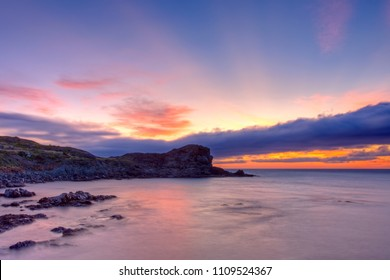 Rugged Newfoundland and Labrador coastline showing the beauty and geological features at sunrise.