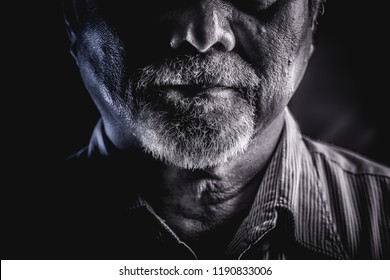 Rugged old man portrait. Old asian man with white beard. Dramatic lighting. Focus on beard.