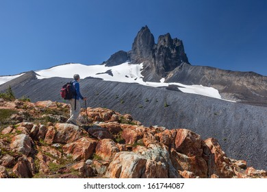 Rugged Peaks with Summer Snow and Hiker (myself)