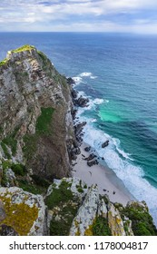Rugged rocks and steep cliffs of Cape Point in the Cape of Good Hope Nature Reserve on the southern tip of the Cape Peninsula in South Africa. The Atlantic and Indian oceans converge at Cape Point.