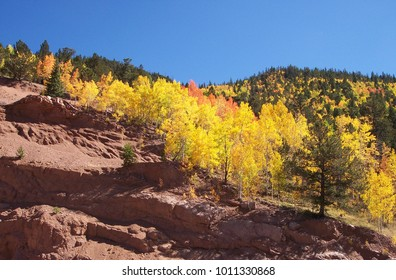 Rugged rocky mountain foreground transitions to the green and gold aspens of autumn, which fade into the high altitude skies of blue for a smorgasbord of textures.