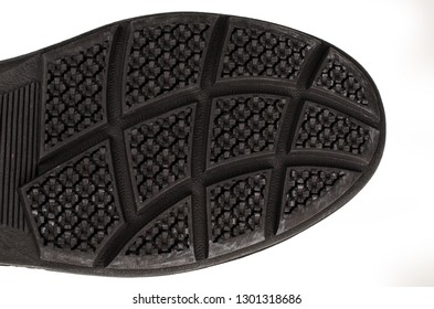 Rugged rubberized shoe sole with a rough texture
