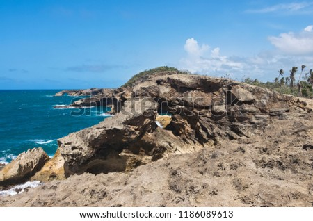 rugged shoreline and atlantic ocean of punta las tunas at cueva del indio north coast puerto rico