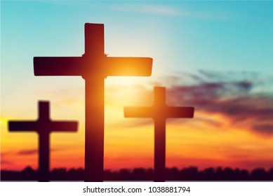 Rugged Silhouette Cross On Sunset Background