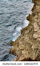 Rugged stony coast of Okinawa island, Japan