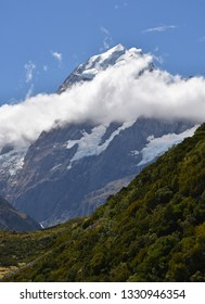 the rugged summit  of mount cook as seen from the hooker valley track near mount cook village on a sunny day in summer on the south island of new zealand