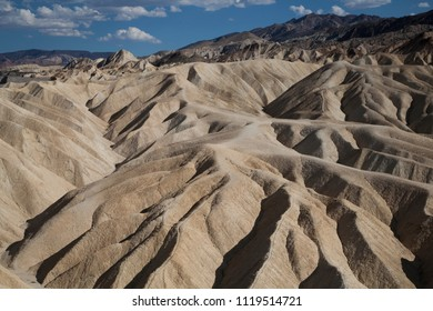 ruggedby landscape at death valley hills at sunrise
