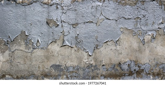 rugh texture background wall with silver peeling paint and chipped over a cement surface