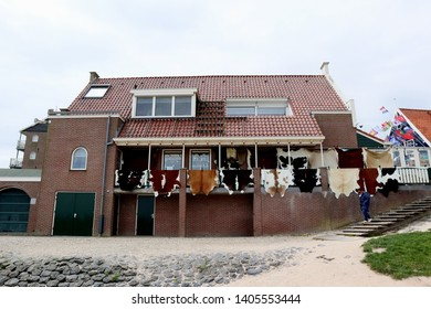 Rugs from cow skin are hung in a house in Volendam, a traditional fishing village outside of Amsterdam that is hugely popular among tourists.