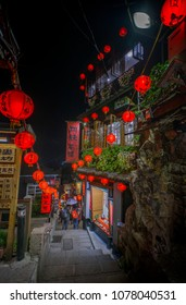 Ruifang, Taipei, Taiwan- Apr 21, 2018: A narrow step street nigt view of the famous traditional A Mei Tea House, Located along Jiufen's old street. tourist spot in Jiufen. Spirited Away