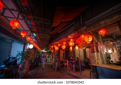 Ruifang, Taipei, Taiwan- Apr 21, 2018: night view of Jiufen old street with red lantern. famous taro rice balls restaurant along street. tourist spot.