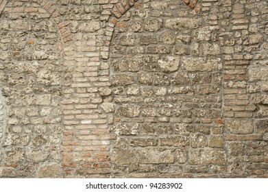 Ruin and ancient gray brick wall surface background texture