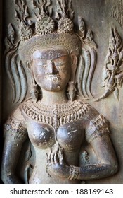 The ruin apsara statue in Angkor temple