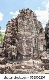 Ruin bayon stone face at gateway of Angkor Wat the world heritage, Siem Reap, Cambodia.