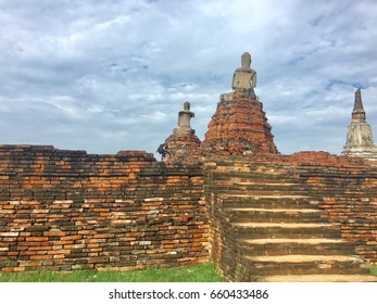 Ruin buddhist statue and pagoda in area of an historical ancient temple in Ayuttaya Thailand, South East Asia.