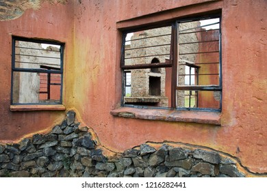 Ruin of a burned down building with rustic colors.