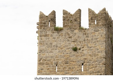 A ruin of a castle tower in an old city. Beautiful landmark symbolizing strength. A historic fort for protection and defense from Europe. A historical medieval ancient architecture. Sightseeing.