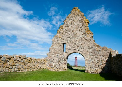 The ruin of a chapel and the lighthouse of Kapelludden, island Oeland, Sweden