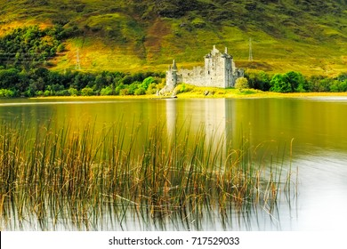The ruin of Kilchurn Castle and mountains reflecting off Loch Awe, Scotland.