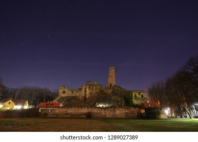 Ruin of old castle under star sky at night.
