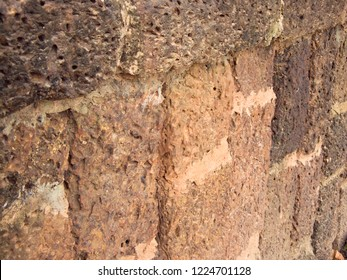 Ruin of old red brick stone, texture background on ancient wall Si Satchanalai Historical Park, Sukhothai province, one of Thailand's world heritage.
