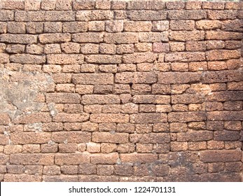 Ruin of old red brick stone, seamless texture background on ancient wall pattern at Si Satchanalai Historical Park, Sukhothai province, one of Thailand's world heritage.