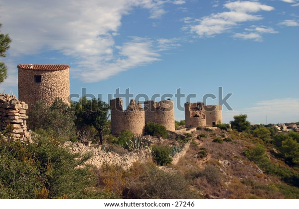 ruin of a turret in blue sky with white clouds in Javea in southern Spains Costa Blanca