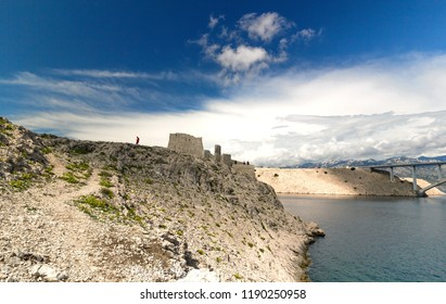Ruine of fortress and the Pag bridge, Island of Pag, Croatia, Europe