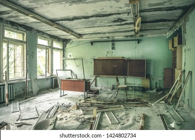 ruined abandoned class room with desks and blackboards in Pripyat school, Soviet Union