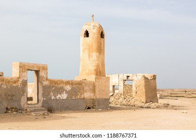 Ruined ancient old Arab pearling and fishing town Al Jumail, Qatar. The desert at coast of Persian Gulf. Abandoned mosque with minaret. Deserted village.