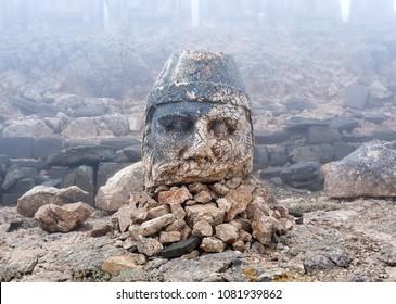Ruined ancient stone statue of Zeus Oromasdes on the top of Nemrut mount, Central Anatolia, Turkey