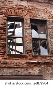 Ruined brick building , broken windows