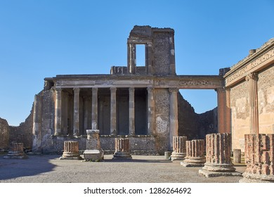 Ruined building with colums in ancient town of Pompei, Naples, Italy