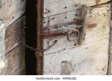 ruined door with padlock